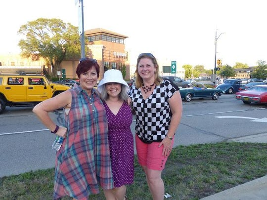 Dream Cruise girls: Heather Irish (left), with sisters Lauren Stein and Heidi Steinman, came out with their families Thursday to watch the cars.