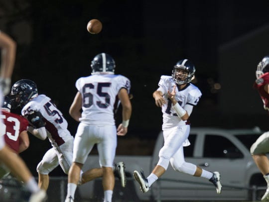 Montgomery Academy's Daniel Lindsey throws a pass during