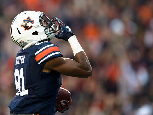 Auburn wide receiver Darius Slayton (81) celebrates after scoring a touchdown during the NCAA football game between Auburn and Georgia on Saturday, Nov. 11, 2017, in Auburn, Ala.