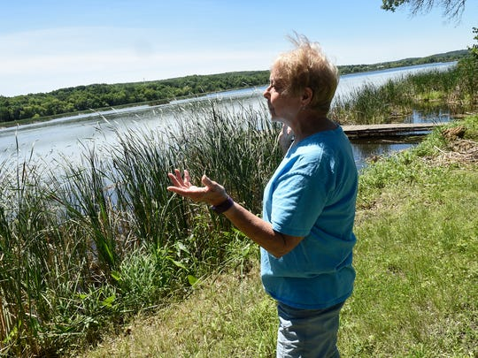 Barb Platten talks about a project to remove floating bogs Thursday, July 5, at Linneman Lake near Avon.