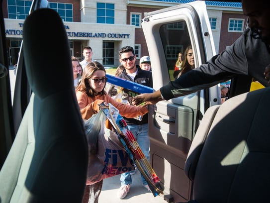 Cumberland County Technical High students load toys