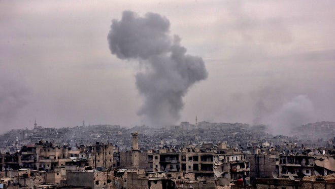 Buildings are destroyed in Aleppo's eastern al-Shaar neighborhood as Syrian pro-government troops advance toward the area during their offensive to retake the city.