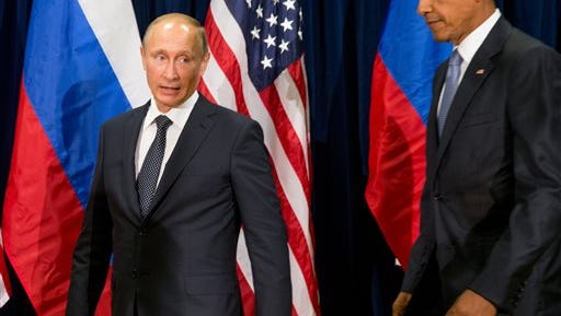 United States President Barack Obama, right, and Russia's President President Vladimir Putin arrive to pose for members of the media before a bilateral meeting Monday, Sept. 28, 2015, at United Nations headquarters. (AP Photo/Andrew Harnik)