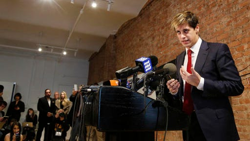 Milo Yiannopoulos speaks during a news conference in New York, Tuesday, Feb. 21, 2017. Yiannopoulos has resigned as editor of Breitbart Tech after coming under fire from other conservatives over comments on sexual relationships between boys and older men.