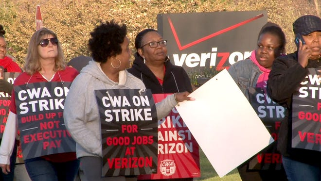 Verizon workers march on a picket line outside the Hamilton call center as they kicked off their strike against the company in April.