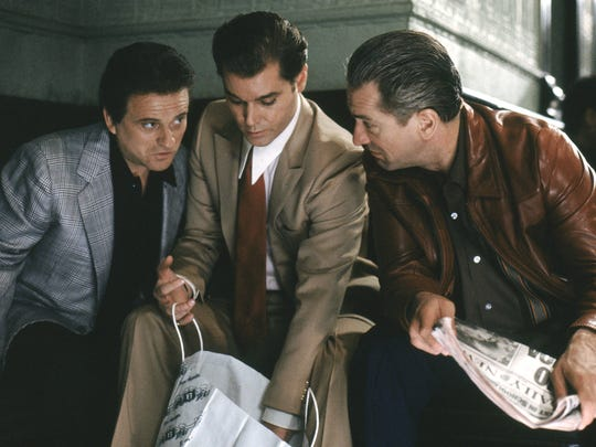 "Joe Pesci (left to right) Ray Liotta and Robert De Niro in ""Good-fellas."""
