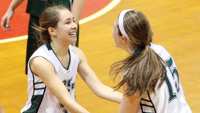 Mount St. Joseph's Jenna Eaton, left, celebrates with teammate Monica Schmelzenbach the Mounties' 42-36 win over West Rutland in the Division IV high school girls basketball state title game at Barre Auditorium on Saturday.