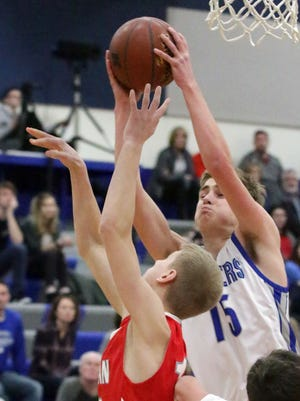 Kohler's Sean Farrell (15) grabs a rebound against Manitowoc Lutheran on Friday in Kohler.