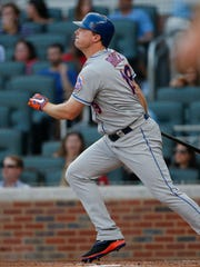 New York Mets' Jay Bruce (19) follows through with a three-run home run in the fifth inning of a baseball game against the Atlanta Braves, Saturday, June 10, 2017, in Atlanta. It was the second game of a doubleheader. New York won 8-1. (