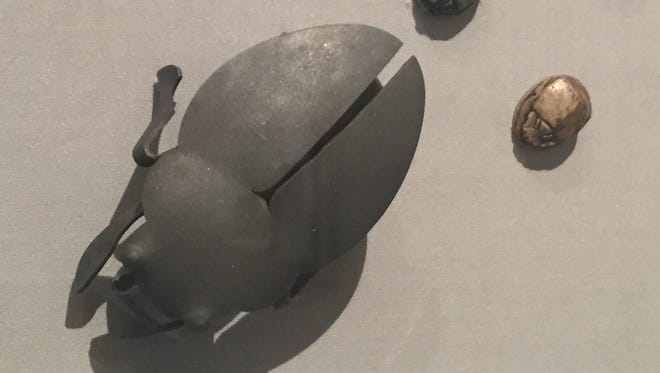 """This photo taken on Dec. 2, 2016 at the Los Angeles County Museum of Art in Los Angeles shows Swiss jeweler David Bielander's 2007 """"Dung Beetle"""" brooch, made out of a metal teaspoon, in the """"Beyond Bling: Jewelry from the Lois Boardman Collection"""" exhibit. The exhibit features 50 jewelry pieces made from unconventional materials and belonging to Southern California collector Boardman's 300-piece jewelry collection, recently donated to the museum. The exhibit opened on Oct. 2, and runs until Feb. 5, 2017."""