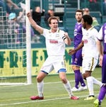 Rhinos midfielder Tyler Rosenlund celebrates scoring the go-ahead goal in the 34th minute of Saturday's 1-1 tie against Orlando City at Sahlen's Stadium.