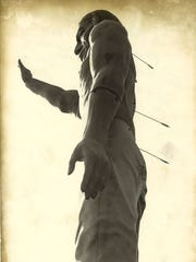 This photograph of arrows shot into the back of the Chief Pontiac statue appeared in the Citizen Times in December 1982. Note the absence of a feather attached to the statue's head.