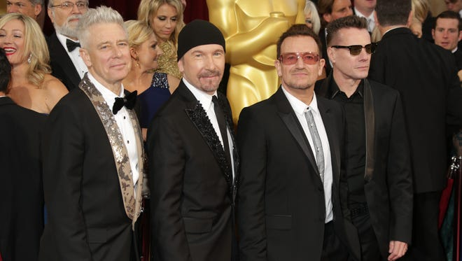 U2 arrives at the 86th annual Academy Awards at the Dolby Theatre.