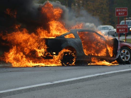 The driver of this Mustang was pulled from the vehicle seconds before it became engulfed in flames after a crash Nov. 9 at U.S. 20 and County Road 198.
