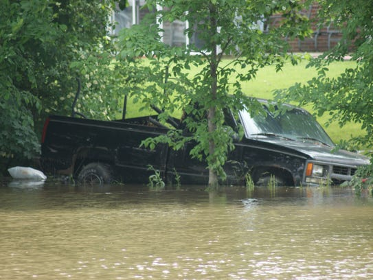 Vehicles were submerged in floodwater as storm sewer