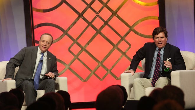 From left, CNN's Paul Begala and Fox's Tucker Carlson on stage at the 2017 Desert Town Hall speaker series March 9, 2017.