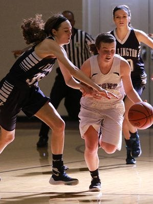 Granville Christian senior Abi Rose drives past Wellington defenders, during the Lions' Division IV district title win.