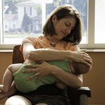 Elizabeth Willis breastfeeds her baby for The Big Latch On in Battle Creek in 2014.