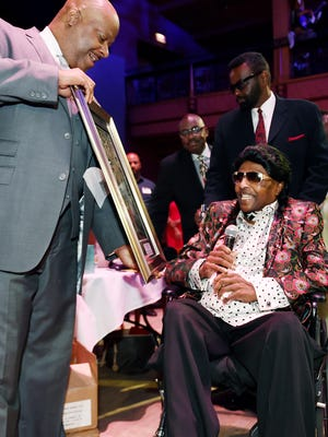 """The National Museum of African American Music President and CEO H. Beecher Hicks, III, left, presents Little Richard with an award during the """"Celebration of Legends"""" luncheon at the Wildhorse Saloon on June 19, 2015."""