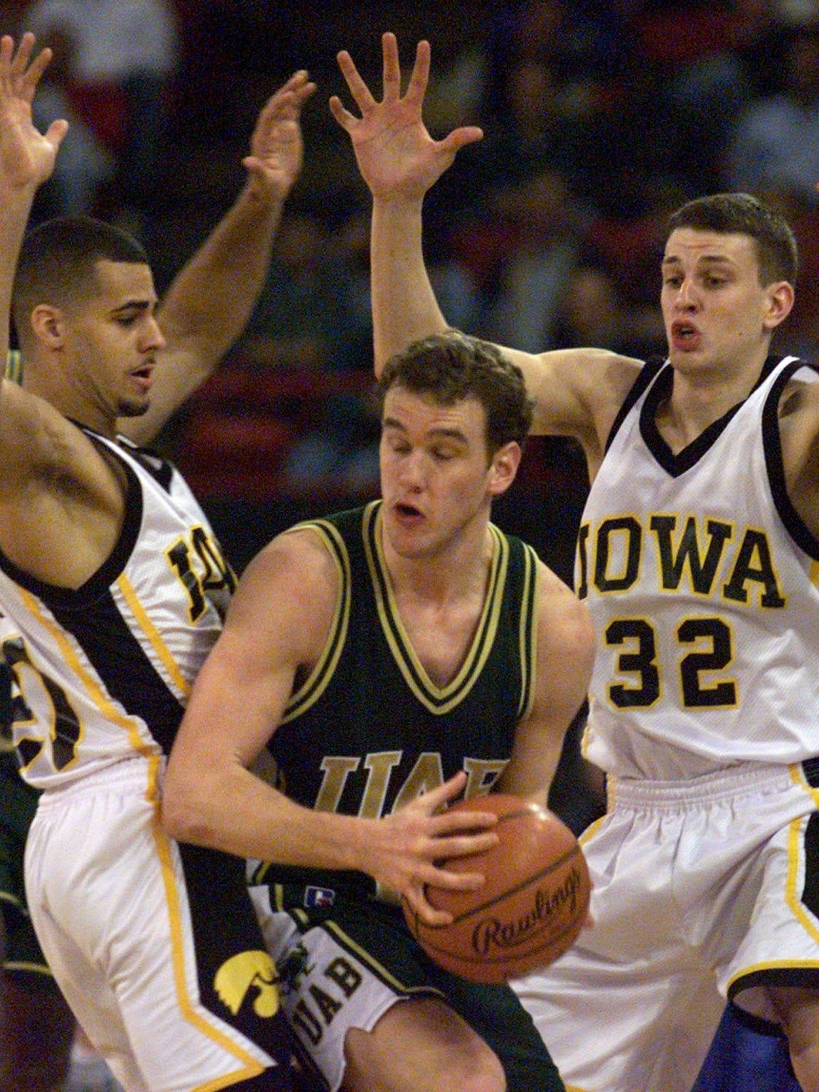 Iowa's Dean Oliver, left and Kent McCausland harrass