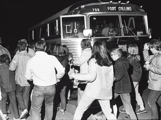 Fans greet the Poudre High School football team as it exits the bus in Fort Collins following winning the state championship in Grand Junction in 1969.