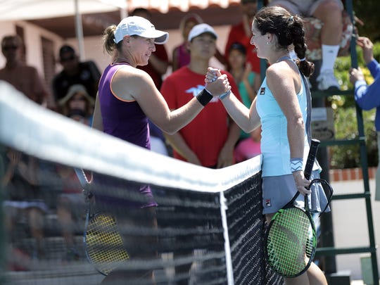 Jamie Loeb, right, shakes hands with Caitlin Whoriskey after repeating as champion of the Hunt Communities $25,000 Women's Pro Tennis Classic at Tennis West.