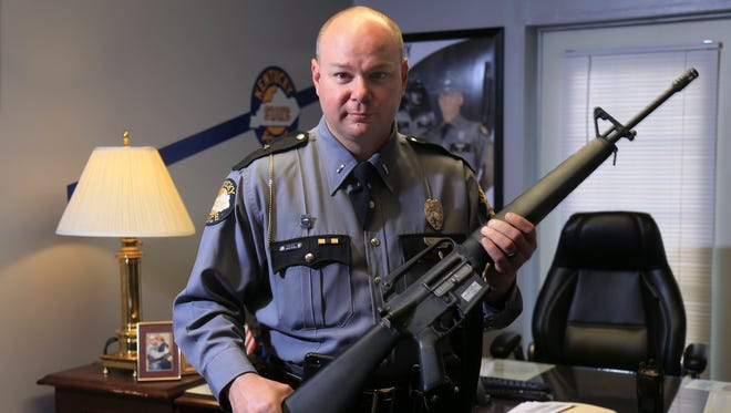 Lt. Michael Webb, with the Kentucky State Police, holds a Vietnam-era rifle that predates him. KSP is pushing for money to replace these relics so they won't be outgunned by criminals.