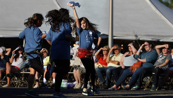 Olivia Fenton, 12, center, of the Alpha Omega Greek Folk Dance Troupe, performs at the 2014 Greek Fest at the Annunciation Greek Orthodox Church in south Fort Myers.