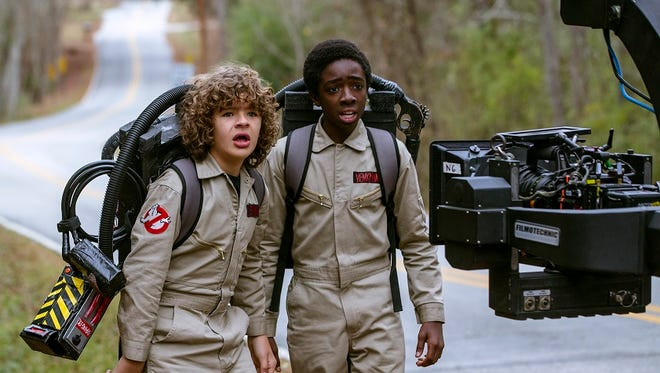 """Cast members Gaten Matarazzo, left, and Caleb McLaughlin are seen with a camera during the making of """"Stranger Things 2,"""" which debuts Oct. 27 at Netflix."""