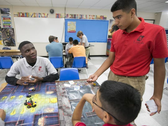 Loyola Academy students Charles Gbekia, left, and Valentin