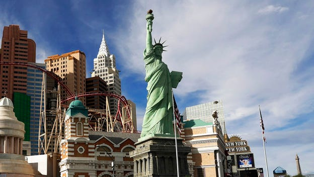 This Feb. 21, 2017 file photo shows the New York New York hotel and casino on the Las Vegas Strip. A judge has ordered the U.S. Postal Service to pay $3.5 million to the sculptor of a Statue of Liberty replica at the New-York-New York casino-resort in Las Vegas after an image of the replica was mistakenly used on a stamp.