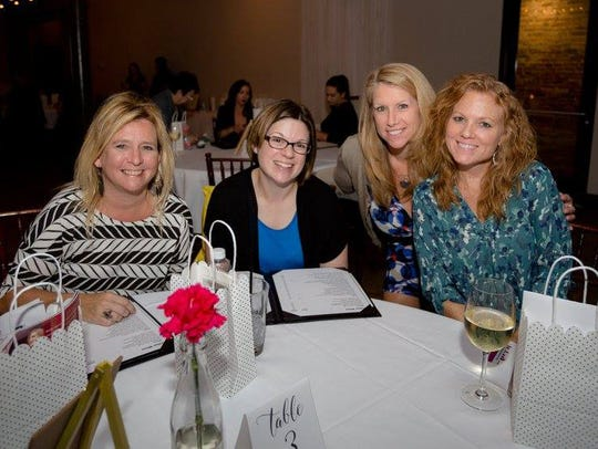 Women gather for a previous Pensacola Housewives monthly