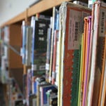 Books are seen displayed in the new library, Monday, Aug. 10, 2015, during a tour of the new Northeast Elementary School in Farmington.