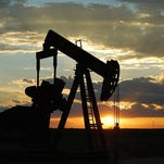 An oil pump continues to pump oil in the twilight of the evening recently.