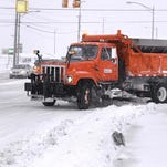 An MDOT snowplow driver rolls down MLK Blvd. and Main St. in Lansing March 12 after yet another snowstorm hit the area.