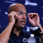Penn State football coach James Franklin adjusts his glasses during his postgame news conference after a 21-3 win over Akron on Saturday, Sept. 6, 2014.