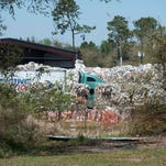 A collection vehicle leaves the West Florida Recycling processing facility located at 8038 North Palafox Street.