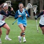 Cape junior Alexa Woodruff maneuvers around Prep's Kristen Shriver during a game at Worcester Prep.