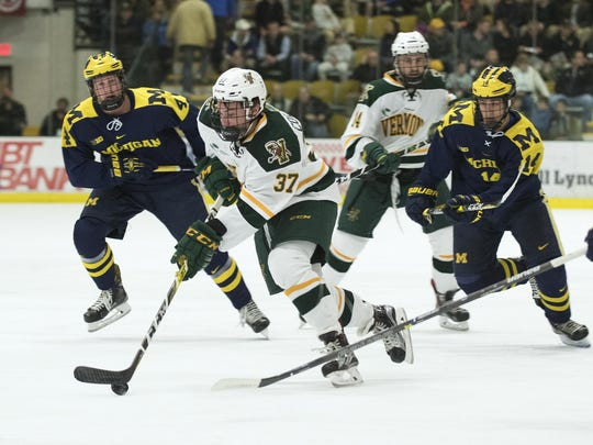 Catatmounts forward Ross Colton (37) skates with the puck during the men's hockey game between the Michigan Wolverines and the Vermont Catamounts at Gutterson Field House on Friday night October 28, 2016 in Burlington. (BRIAN JENKINS/for the FREE PRESS)