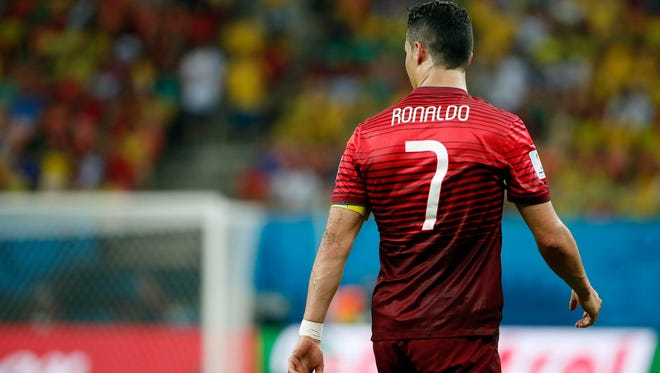 Jun 22, 2014; Manaus, Amazonas, BRAZIL; Portugal forward Cristiano Ronaldo (7) during their 2014 World Cup game against the United States at Arena Amazonia.