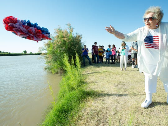 Ruth Mills, of Las Cruces, toss a wreath in the Rio Grande in memory of her husband Raymond, on Memorial Day during a wreath-laying ceremony at La Llorona Park on Monday, May 29, 2017. Mr. Mills served and retired after 24 years in the U.S. Army.  He passed away in 1995.
