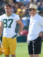 General manager Ted Thompson, right, talks with receiver Jordy Nelson (87) during training camp practice at Ray Nitschke Field.