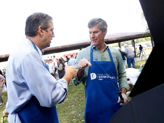 U.S. Rep. Tim Ryan (D-OH) fist bumps Democratic gubernatorial