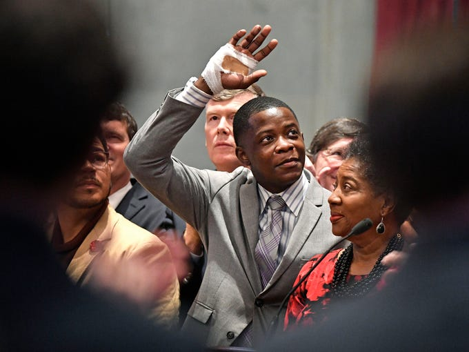 James Shaw Jr. waves to the crowd and legislators inside