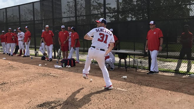 Washington Nationals pitcher Max Scherzer throws from the mound during Thursday's first official workout for pitchers and catchers at the Fitteam Ballpark of The Palm Beaches.