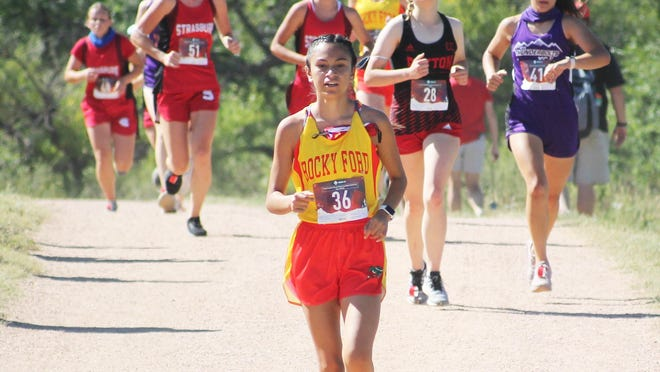 Rocky Ford High School's Katie Preciado leads a pack of runners at the Cheyenne Mountain Stampede Saturday in Colorado Springs. Preciado was 15th overall and the Lady Meloneers finished seventh as a team.