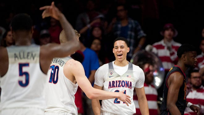 Arizona Wildcats center Chance Comanche (21) and forward Lauri Markkanen (10) celebrate after scoring against the Southern California Trojans during the first half at McKale Center, Feb. 23, 2017.