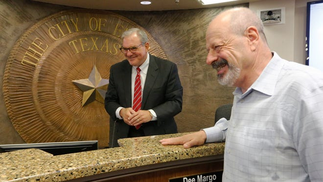 El Paso Mayor-elect Dee Margo shares a laugh with outgoing Mayor Oscar Leeser on Monday. Leeser's last day in office was Monday, with Margo being sworn in Tuesday.