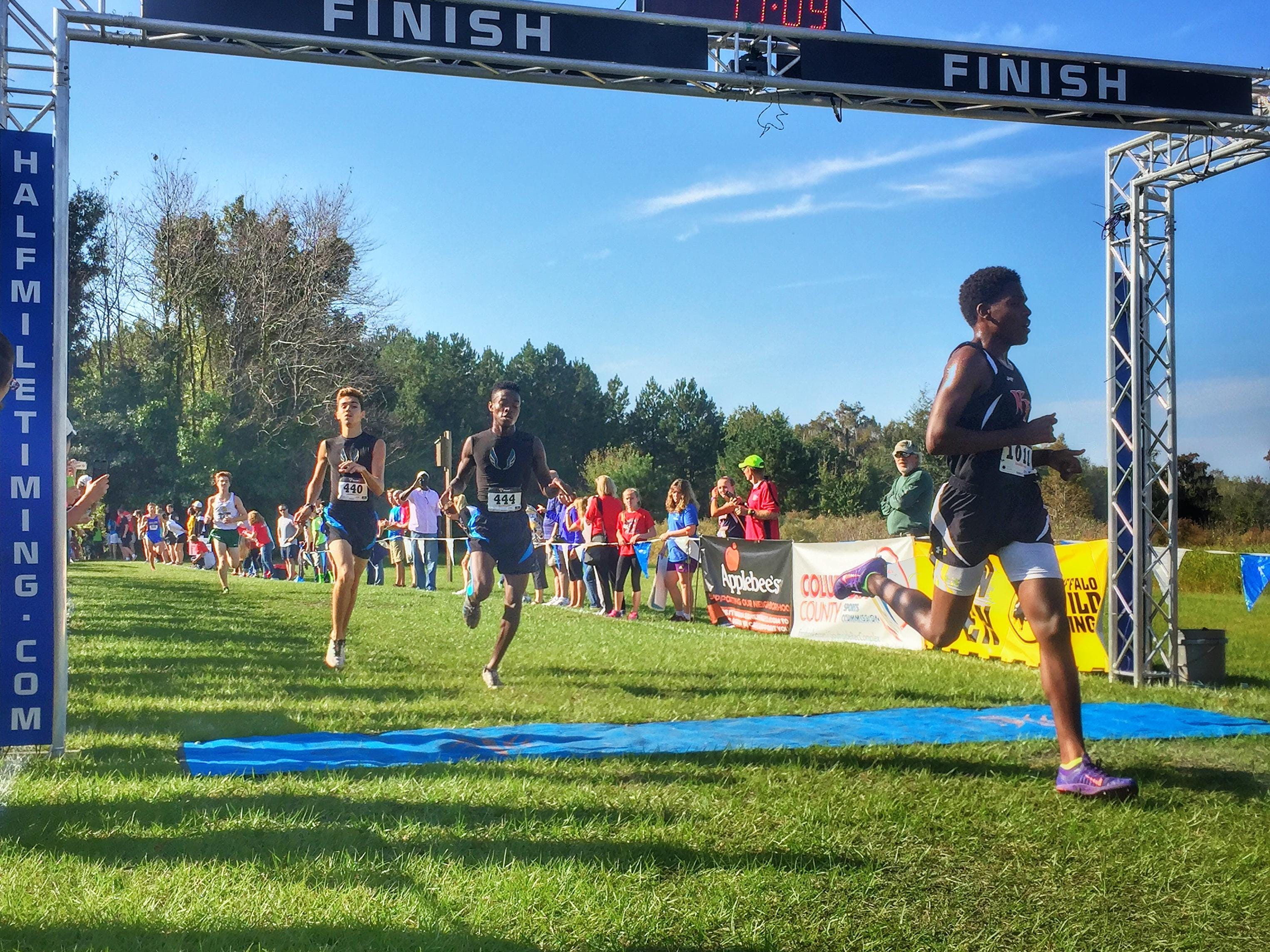 Rickards senior Solomon Stevens narrowly beats teammate Evan Garrison during Saturday's Region 1-2A meet in Lake City. The pair broke the school record and qualified for the state meet with top 15 finishes.