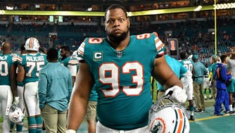 Miami Dolphins defensive tackle Ndamukong Suh (93) reacts on the bench during the second half against the Buffalo Bills on Dec. 31 at Hard Rock Stadium.